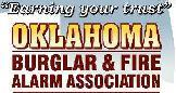 Oklahoma City Burglar and Fire Logo